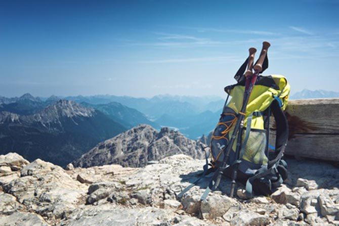 Backpack or rucksack balanced against a rock on top of a mountain summit in the Alps, Hochvogel, Germany, conceptual of a healthy, active outdoor lifestyle and sport. Quelle: © XtravaganT / Fotolia.de
